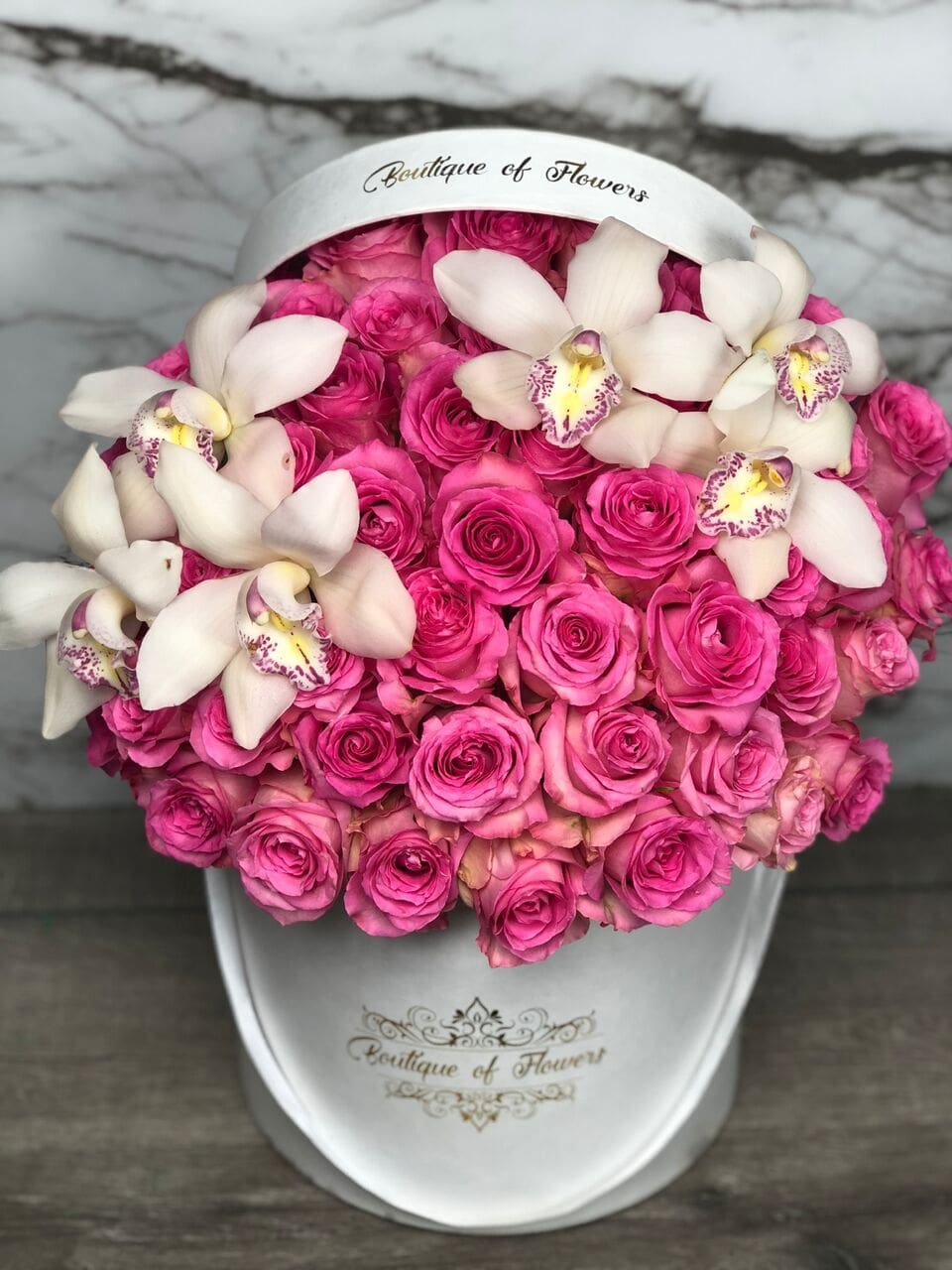bright pink rose withn orchid round box